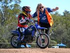 DOING IT FOR THE KIDS: Volunteer Michelle Jenner helps the pee wee riders on the motocross track at the Chinchilla State School P&C;'s mini trail ride and family fun weekend.