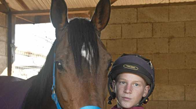 Toowoomba mare Sold For Song with her strapper Nick Keal at trainer Kevin Kemp's stables this week.