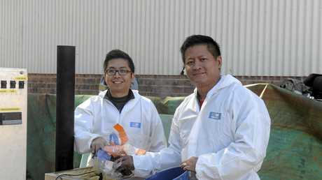 Eugene Keh and Songpol Boonsawat with their system that turns unwanted plastic into a more sustainable product.