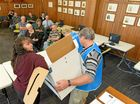 Returning officer Lisa Stout draws a name from the ballot box at the ballot draw for the 2016 Clarence Valley Council election.