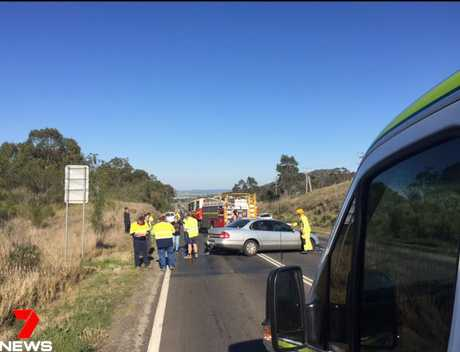 Emergency services at the scene of a three-vehicle crash on the Gore Hwy at Drayton.