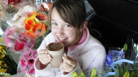 Lee-Tisha Hansen, 10, enjoys a hot chocolate at Deli Delicious.