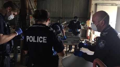 Police are removing hundreds of litres of chemical and fertiliser from a Lockyer valley home linked to a grow house.