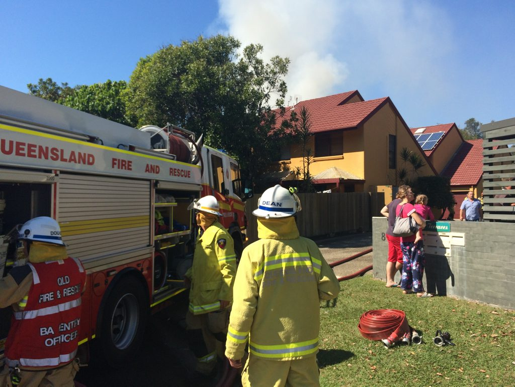 Firefighters respond to a fire which destroyed a townhouse in Mt Coolum.