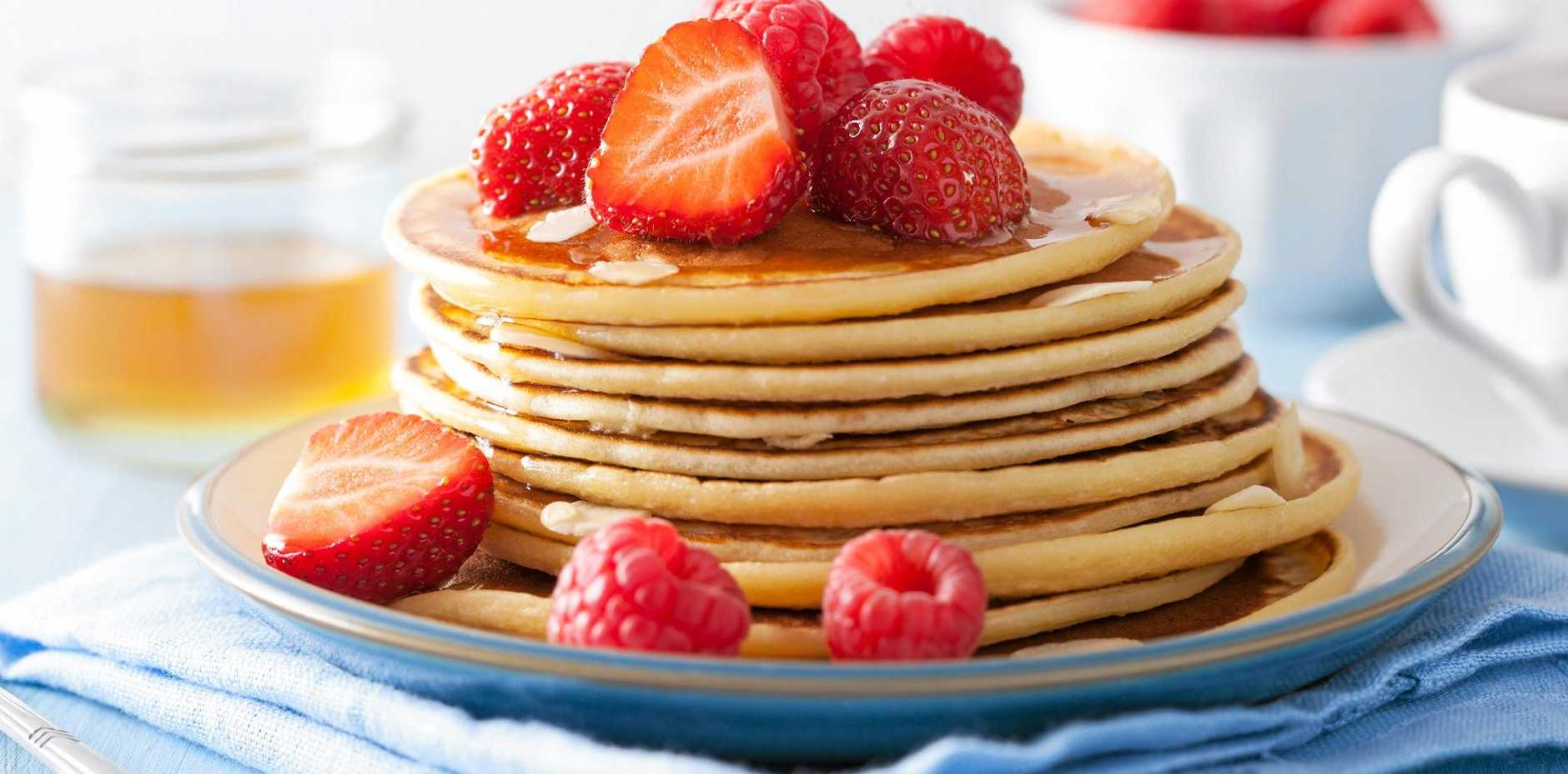 Treat yourself to pancakes with berries and maple syrup.