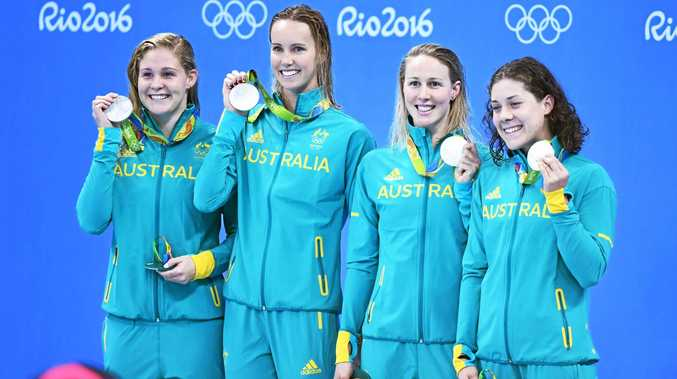 Leah Neale (far left) poses with teammates after claiming the silver medal in the 4x200m freestyle relay final in Rio.Photo: swimming.org.au