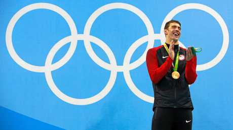 Michael Phelps celebrates winning another gold.