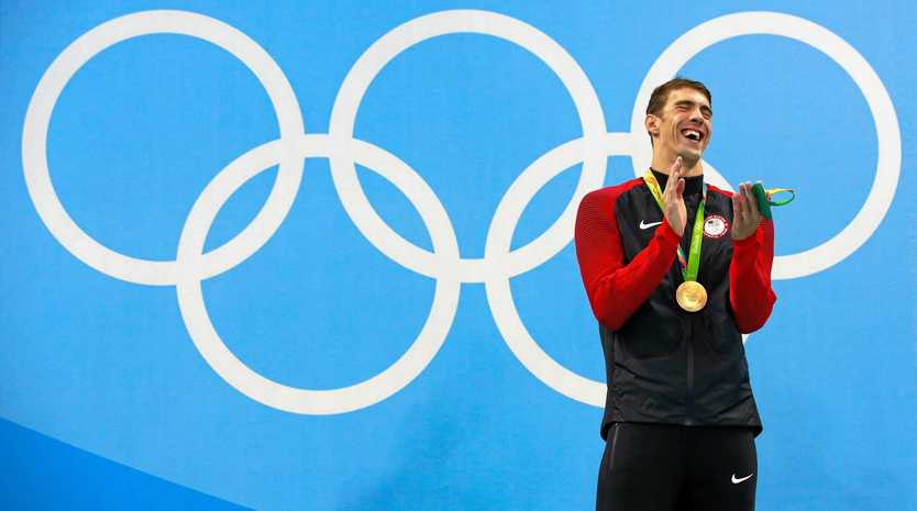 RIO DE JANEIRO, BRAZIL - AUGUST 09:  Gold medalist Michael Phelps of the United States poses on the podium during the medal ceremony for the Men's 200m Butterfly Final on Day 4 of the Rio 2016 Olympic Games at the Olympic Aquatics Stadium on August 9, 2016 in Rio de Janeiro, Brazil.  (Photo by Adam Pretty/Getty Images)