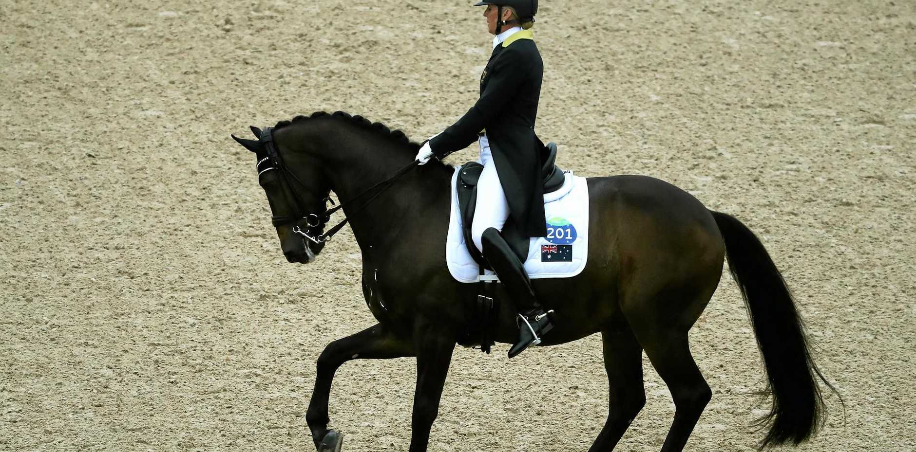 Mary Hanna of Australia riding Boogie Woogie 6 competes during the Dressage Individual Grand Prix.
