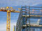 Construction cranes work on the Sunshine Coast.