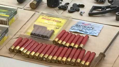 DEADLY WEAPONS: A row of what appear to be shotgun shells seized by police this morning.