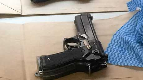 ILLEGAL: One of the replica hand guns seized by police at a Lagoon Grass property.
