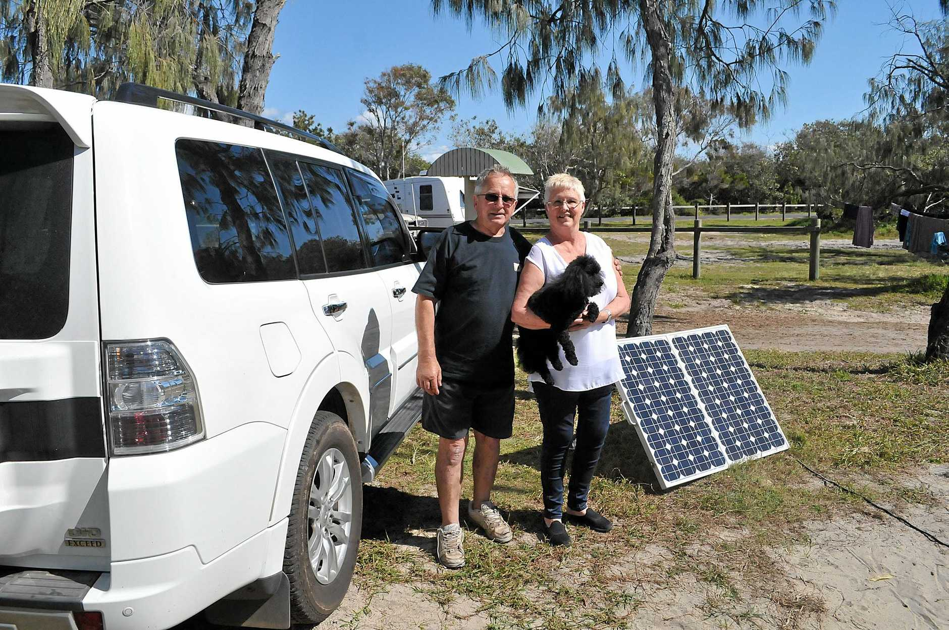 RETURN TO THE SCENE: It takes more than a disaster to keep Jenny and Dieter Gass (and their loyal canine savior Georgie) away from Inskip Point, which they say is the best spot in Australia.