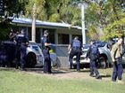 Police at the scene of a drug bust at Bundamba on Friday morning.