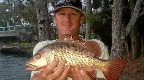 Pat Holden  pictured with a mangrove jack.