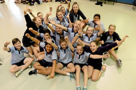 Silkstone State School students cheer on former student Leah Neale as she leads the Australian Womens 200m freestyle relay team at the Rio Olympics.