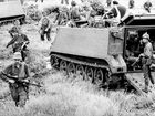 In this Aug. 19, 1966 photo released by Australian War Memorial, troops of 1APC Squadron and infantry sweep the area the day after the battle of Long Tan in then Phuoc Tuy province of South Vietnam, now Ba Ria-Vung Tau province of Vietnam. On Thursday, July 26, 2012, Hanoi lent Australia a cross built by Australian soldiers in Long Tan in 1969 during the Vietnam War in memory of their fallen comrades. The gesture is a milestone in the former enemies' warming relations. (AP Photo/Australian War Memorial)