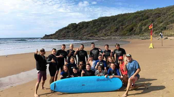 SUCCESS STORY: 'Grom' Mellick takes 17 backpackers on a surfing lesson at Agnes Water.