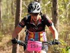 Briony Beales puts her bike through the tough terrain.