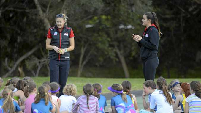 GUIDING THE FUTURE: SP Netball coaches and Netball NSW Swifts team members Susan Pettitt and Amy Sommerville at a coaching clinic with Grafton junior netball girls at the weekend.
