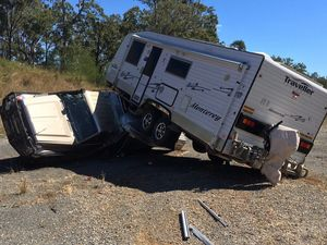 4WD and caravan rollover on Bruce Hwy