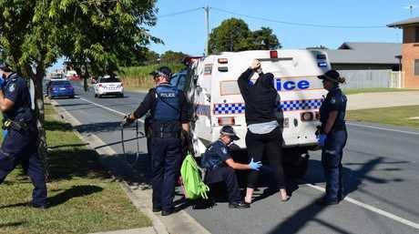 Police seach a woman.Photo: Emily Smith