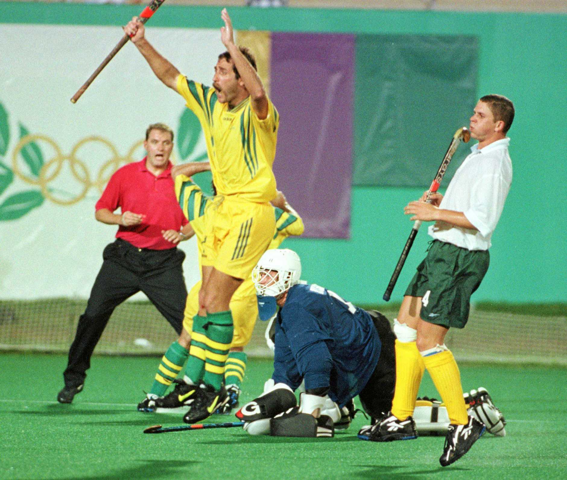OLYS130 ATLANTA JULY 21 AAP (HOCKEY) - Australian captain Mark Hager leaps into the air after narrowly missing a shot at goal during the match played against South Africa today. AAP PHOTOS/RUSSELL MCPHEDRAN (AAP POOL)