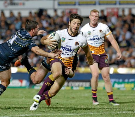Broncos Ben Hunt tackled by Cowboys defenders Lachlan Coote, left, and Jake Granville (obscured) , during the round 11 NRL match between the North Queensland Cowboys and the Brisbane Broncos at 1300 Smiles Stadium in Townsville, Friday, 20th May, 2016. (AAP Image/Michael Chambers) NO ARCHIVING, EDITORIAL USE ONLY