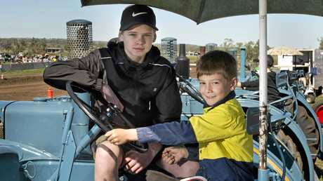 The late Kent Mason's son Bradley (left), 12, and his nephew Max Mason, 7, ride his tractor.