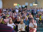 Residents fill Peregian Springs State School indoor sports centre for a community meeting about a fight to maintain the suburb's golf course.