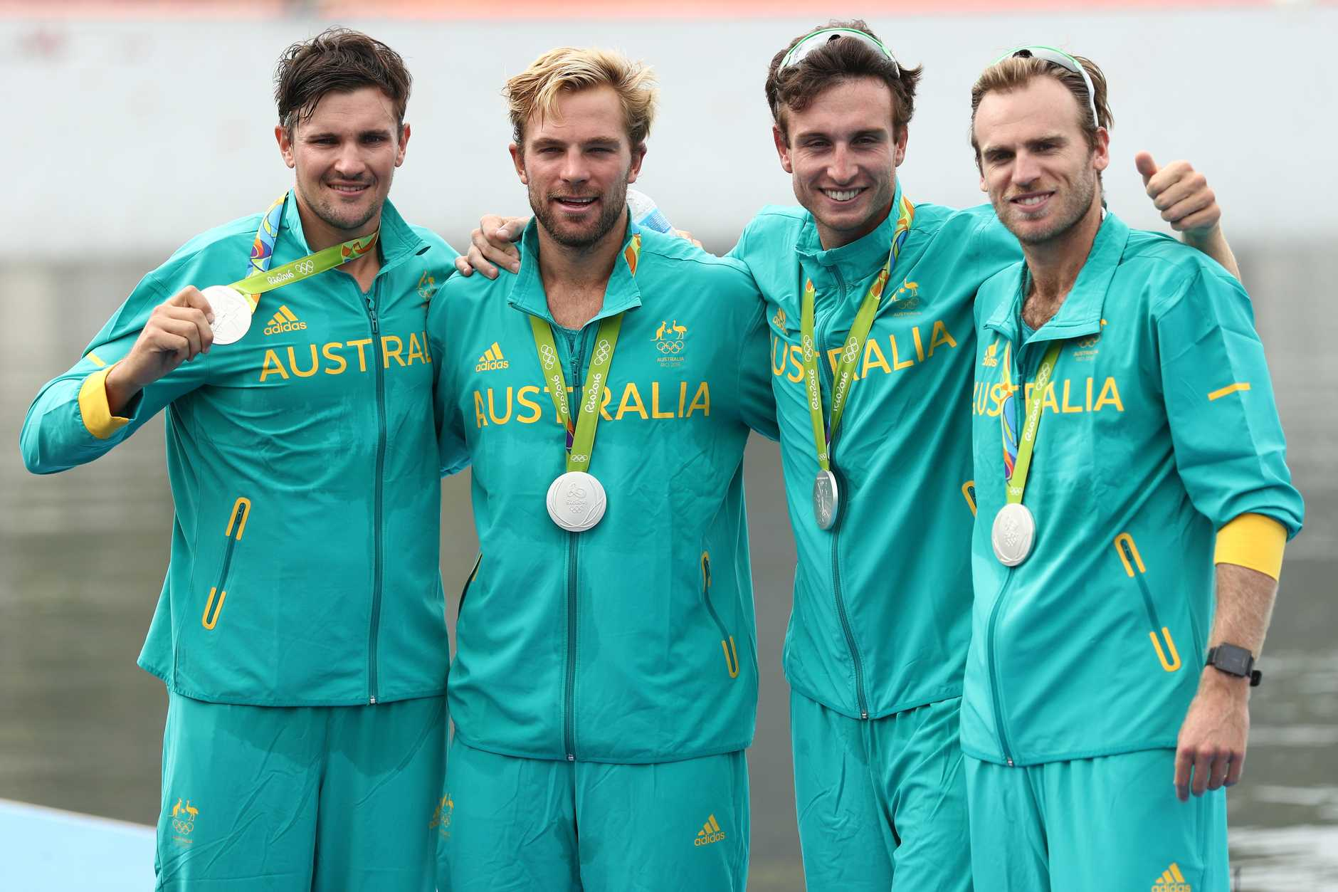 RIO DE JANEIRO, BRAZIL - AUGUST 12: Silver medalists William Lockwood, Joshua Dunkley-Smith, Joshua Booth and Alexander Hill of Australia pose for photographs on the podium at the medal ceremony for the Men's Four on Day 7 of the Rio 2016 Olympic Games at Lagoa Stadium on August 12, 2016 in Rio de Janeiro, Brazil. (Photo by Patrick Smith/Getty Images)