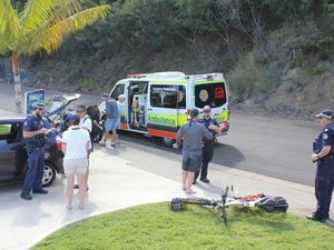 Car collides with push bike outside marina entrance