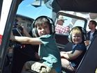 Brother and sister Kyan and Aria Woods had a go 'flying' a plane.Photo: Emily Smith