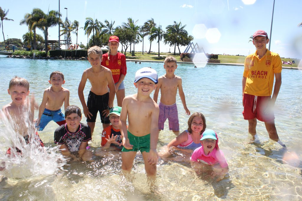 Charlie and Steven Dickinson with Daniella Eardman, Tyler Baxter, Liam Goldie, Bryson Henshaw, Gemma Ross, Tarni Henshaw, Billy Baxter and life guards Alazay Lane and Ned Sleight enjoying the kids activities after the Recyclable Regatta.Photo Peter Carruthers / Whitsunday Times