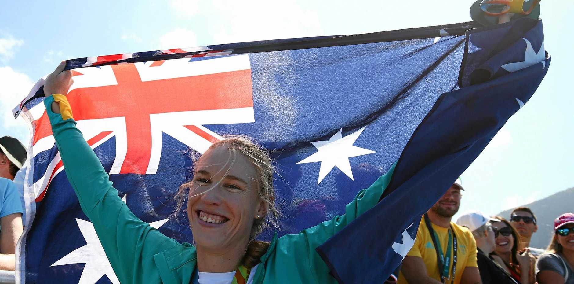 Gold medalist Kimberley Brennan of Australia celebrates after the medal ceremony for the women's single sculls.