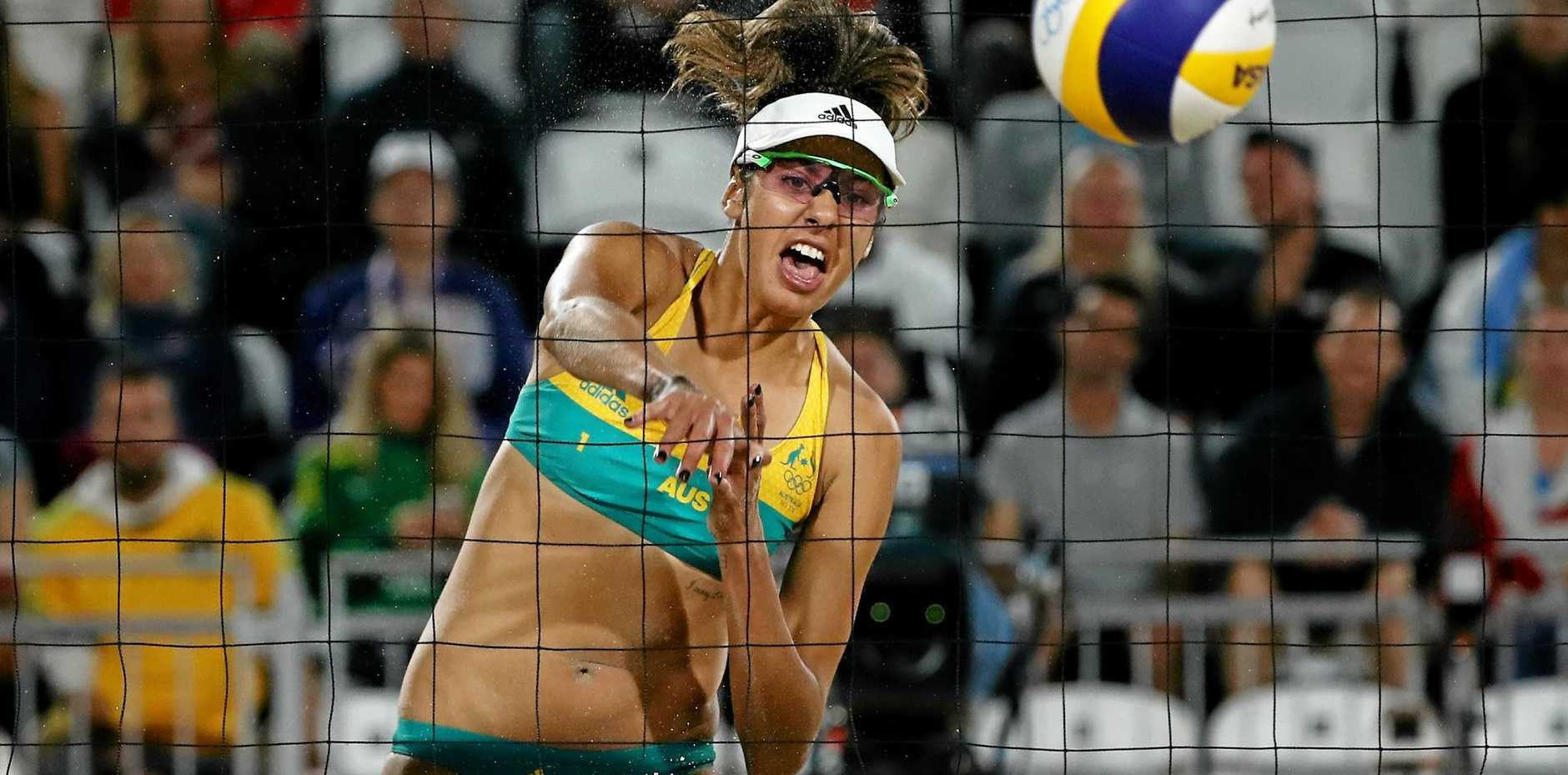 Taliqua Clancy of Australia spikes the ball in the win over Poland.