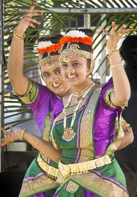 UNITED: Sisters Maria (left) and Sara Mathews perform at the 11th Toowoomba Languages and Cultures Festival yesterday in Queens Park.