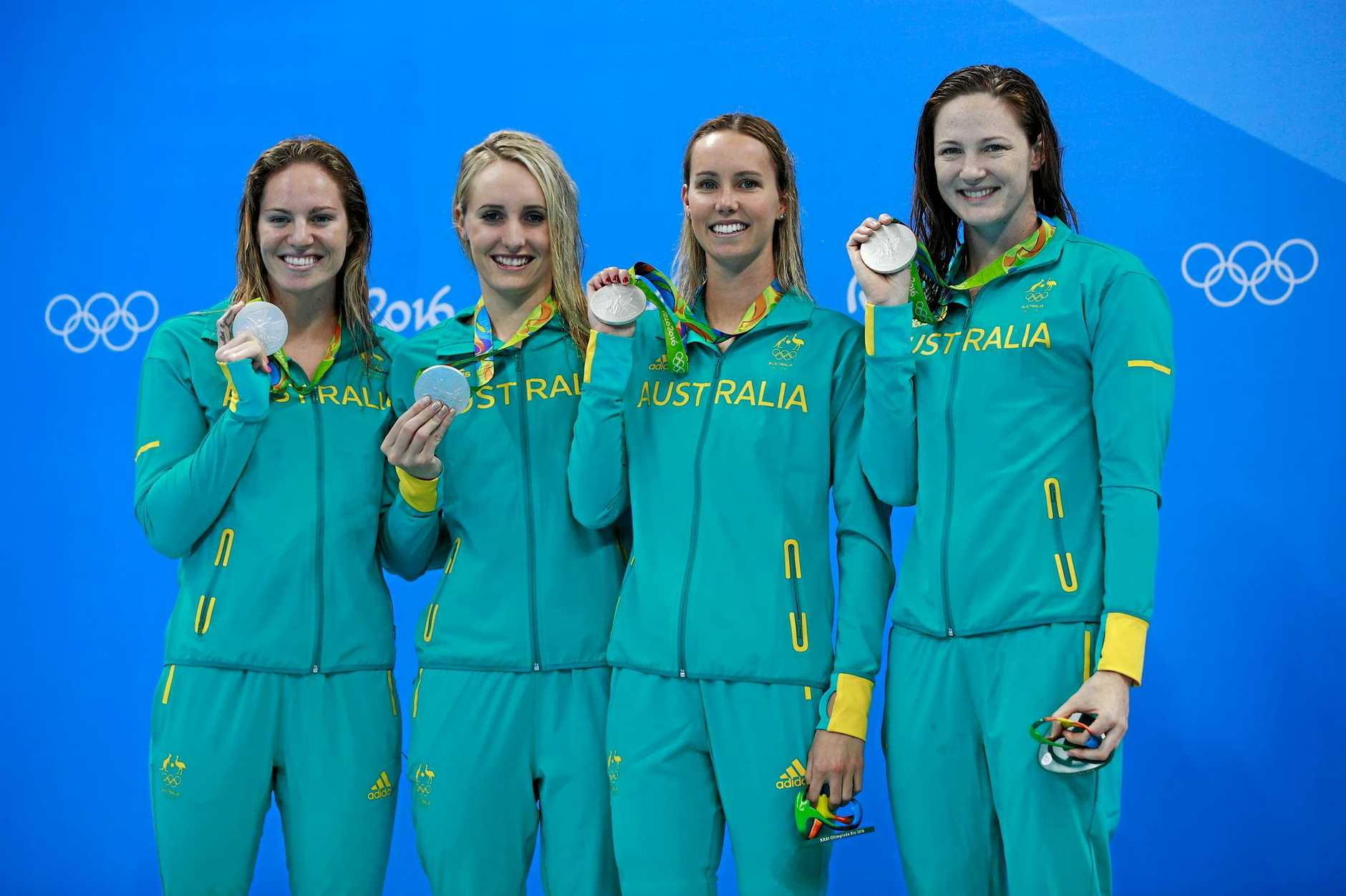 RIO DE JANEIRO, BRAZIL - AUGUST 13:  Silver medalists Emily Seebohm, Taylor McKeown, Emma McKeon and Cate Campbell of Australia celebrate on the podium during the medal ceremony for the Women's 4 x 100m Medley Relay Final on Day 8 of the Rio 2016 Olympic Games at the Olympic Aquatics Stadium on August 13, 2016 in Rio de Janeiro, Brazil.  (Photo by Adam Pretty/Getty Images)