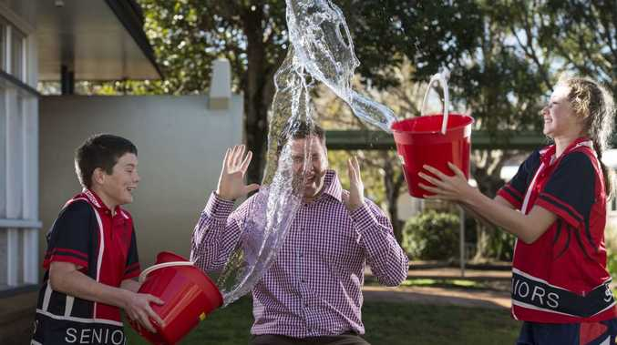 Rangeville State School leaders Dylan Hickey and Ella Milne give past student Cr Geoff McDonald a taste of what to expect when he participates in the Dunk a Teacher at the upcoming school fete, Friday, August 12, 2016.