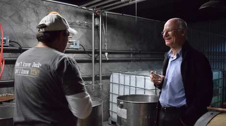 NICE DROP: Dr Lou Muller dropped into Bundaberg to try Waterview's new Pure spirit, made with cane juice, with founder Matthew Drane. Photo: Eliza Goetze / NewsMail