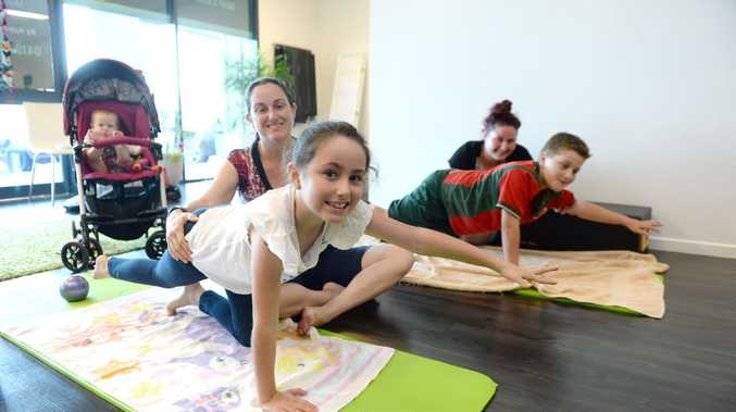 Katie Prince with the help of her mother Michelle and sister Emily Prince, and Isaac Butler with his mother Amy Butler get into the action at pilates classes for children.