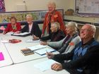 Tugerah Lakes U3A members with president Pam McGlinn (standing) at a writers workshop
