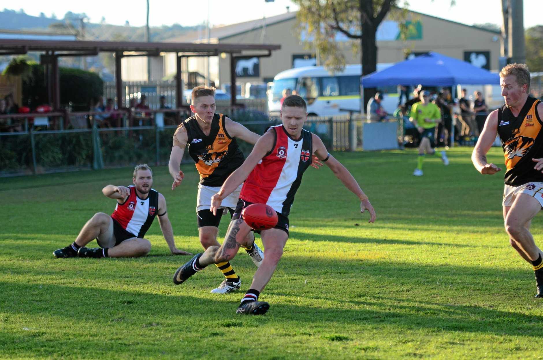 POINTS HUNT: South Burnett Saints' Paul Judge punts the ball towards goal against Toowoomba.