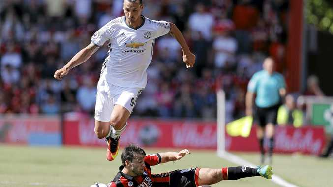 Manchester United's Zlatan Ibrahimovic, left, and Bournemouth's Harry Arter challenge for the ball.