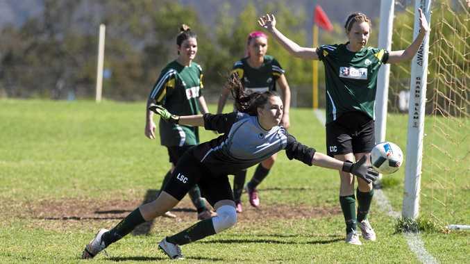 SHOT STOPPER: Laidley Wild Cats keeper Dannielle Alexander dives against USQ FC Ladies.