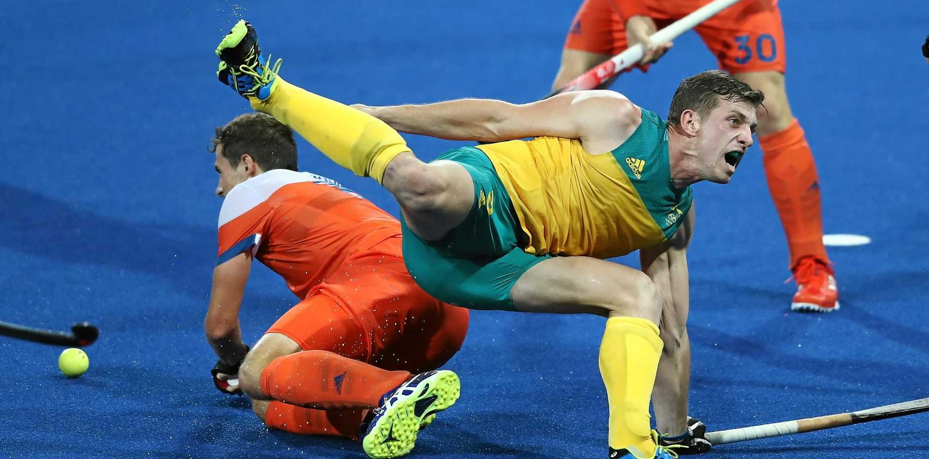 Simon Orchard of Australia is brought down in the Kookaburras' defeat to the Dutch.