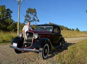 Restored cars on display for vintage car rally