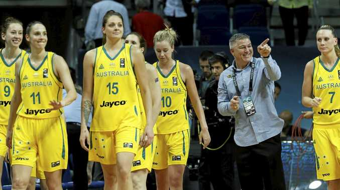 MEDAL DREAMS: Australia's head coach Brendan Joyce and his players.