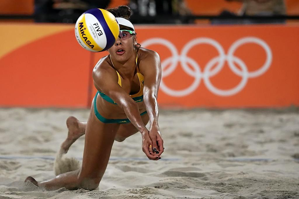 RIO DE JANEIRO, BRAZIL - AUGUST 14:  Taliqua Clancy of Australia dives for the ball during a Women's Quarterfinal match between the United States and Australia on Day 9 of the Rio 2016 Olympic Games at the Beach Volleyball Arena on August 14, 2016 in Rio de Janeiro, Brazil.  (Photo by Sean M. Haffey/Getty Images)