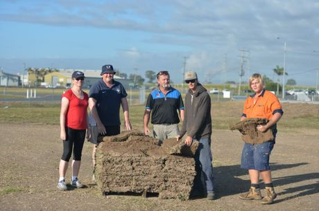 Mackay Regional Football Zone president Scott Mealy (centre) laying turf at the fields with the help of volunteers Fiona and Dean Lynch, Adam Foley and Chris Redman. Photo Madolyn Peters / Daily Mercury